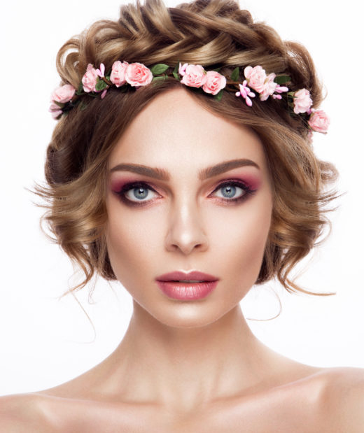 Fashion Beauty Model Girl with Flowers Hair. Bride. Perfect Creative Make up and Hair Style. Hairstyle. Beautiful Flowers